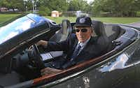 Dr. Kenneth Cooper and his Aston Martin at the Cooper Aerobic Center in Dallas(Louis DeLuca/Staff Photographer)