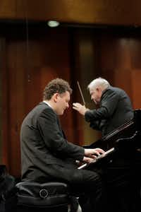 "<p>Yury Favorin performs&nbsp;<span style=""font-size: 1em; background-color: transparent;"">the Prokofiev Concerto No. 2&nbsp;</span><span style=""font-size: 1em; background-color: transparent;"">with conductor Leonard Slatkin and the Fort Worth Symphony Orchestra in the final round of the Van Cliburn International Piano Competition Friday at Bass Performance Hall. (Ralph Lauer/Van Cliburn Foundation)</span></p><p><br></p>"