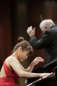 Pianist Rachel Cheung performed with conductor Leonard Slatkin and the Fort Worth Symphony Orchestra in the final round of the Van Cliburn International Piano Competition on Saturday. (Ralph Lauer/Van Cliburn Foundation)