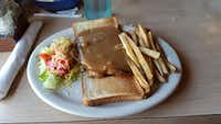 Open-face hot roast beef sandwiches are among the variety of dishes on the menu at Isaack Restaurant.(Frank L. Christlieb/Staff)