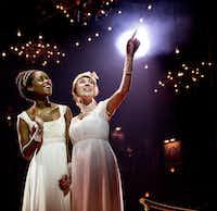 "Denee Benton, left, and Brittain Ashford during a performance of ""Natasha, Pierre & the Great Comet of 1812,"" in New York. (Chad Batka/Matt Ross Public Relations via AP)"