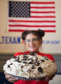 Waitress Ataly Rozo shows off a Mile-High Oreo Cream Pie at the new Norma's. (Ryan Michalesko/Staff Photographer)