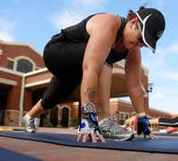 Rhonda-Lee Foulds stretches at the end of a Camp Gladiator workout.<div><br></div>(Ron Baselice/Staff Photographer)