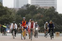Catherine Cuellar, in the orange-and-yellow vest, rode her bike to City Council in October 2015 with other Dallas residents and City Council members.(File Photo/Staff Photographer)