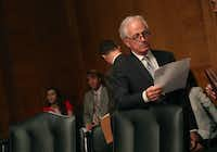 Sen. Bob Corker, R-Tenn., looked over his papers during a Senate Banking, Housing and Urban Affairs Committee hearing on Capitol Hill on June 6. (Mark Wilson/Getty Images)