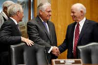 Secretary of State Rex Tillerson (center) is greeted on Capitol Hill in Washington on Tuesday by Senate Foreign Relations Committee Chairman Sen. Bob Corker , R-Tenn. (left), and the committee's ranking senator, Ben Cardin, D-Md., before testifying before the committee.(Jacquelyn Martin/The Associated Press)