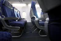 This 2012 file photo shows where American Airlines removed a row of seats in order to create more leg room. The airline just reversed a recent decision to install three rows of seats with just 29 inches between them.(Brad Loper/Staff Photographer)
