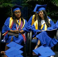 Valedictorian Eleni T-Giorgs (left) and Salutatorian Bae Shae attend the Emmet J. Conrad High School Commencement Ceremony at Alfred J. Loos Fieldhouse in Addison on May 31.(Jae S. Lee/Staff Photographer)