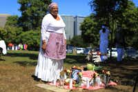Wanda Blake with an altar of symbolic foods during a Juneteenth Ritual of Remembrance in Oakland, Calif., June 10, 2017. The holiday, which celebrates the abolition of slavery in the United States, is an occasion to gather and eat. (Jim Wilson/The New York Times)(Jim Wilson/The New York Times)