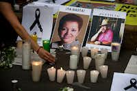 A candle is placed in front of pictures of murdered journalists Miroslava Breach (left) and Javier Valdez during a demonstration against the killing of journalists outside the Interior Ministry in Mexico City. Valdez's killing spurred an outcry unseen previously during the tragically frequent murders of Mexican journalists. It has drawn together competing outlets, as well as foreign governments, the international press and human rights organizations in broad condemnation.(Rebecca Blackwell/AP)