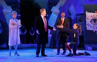 In this May 21 photo, Tina Benko (left) portrays Melania Trump in the role of Caesar's wife, Calpurnia, and Gregg Henry (center left) portrays President Donald Trump in the role of Julius Caesar during a dress rehearsal of the Public Theater's free Shakespeare in the Park production of <i>Julius Caesar</i> in New York. (Joan Marcus)