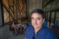 Dallas artist Ricardo Salas on the patio at Houndstooth Coffee, where his work will hang during the June 24 Summer Solstice Artspot at Sylvan Thirty, the inaugural event of the new Oak Cliff nonprofit Over the Bridge Arts. (Robert W. Hart/Special Contributor)