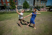 <p></p><p>Marissa Marez (left) and Lori Sundeen Soderbergh, co-founders of the new Oak Cliff nonprofit Over the Bridge Arts, dance on the lawn outside Cibo Divino. Local artists, dancers and musicians will participate June 24 in Summer Solstice Artspot, the organization'€s inaugural event, in and around the shops at Sylvan Thirty.</p><br>(Robert W. Hart/Special Contributor)