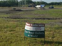 "When seeing a parks department employee placing a bond project sign at the tower site in November, the true landowner told the employee that the ""city was placing dirt on his property."" That should have led to deed record research before construction started on the radio tower, according to a consultant's report.(Ray Leszcynski/Staff)"