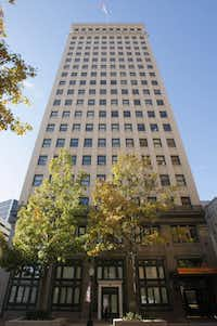 The W.T. Waggoner building, at 810 Houston Street in downtown Fort Worth, is the corporate headquarters for XTO Energy. Most employees will start moving to Exxon Mobil's Houston area campus starting next year.(RODGER MALLISON/STAR-TELEGRAM/RODGER MALLISON)