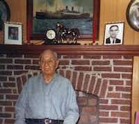 Thomas Cummings Sr., a World War I veteran, poses in front of his living room fireplace, which was a shrine to his military experience.(Cummings family)