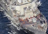 The damaged USS Fitzgerald, as seen Saturday off Yokosuka, near Tokyo. (Hitoshi Takano/Kyodo News)