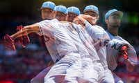 A multiple exposure photograph shows Texas Rangers starting pitcher Yu Darvish as he pitched during the second inning against the Seattle Mariners at Globe Life Park on Sunday.(Smiley N. Pool/Staff Photographer)