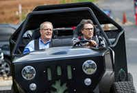 Energy Secretary Rick Perry, right, said the debate over climate change should focus on how much it's changing.(Erik Schelzig/The Associated Press)