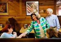 Karen Handel, Republican candidate for Georgia's 6th Congressional District, greeted diners Monday during a campaign stop at Old Hickory House in Tucker, Ga. The race between Handel and Democrat Jon Ossoff is seen as a significant political test for the Trump administration.(David Goldman/The Associated Press)