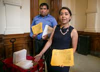 "Daniel Candelaria, left, and Karla Perez, both DACA beneficiaries from Houston, arrive at the Capitol on April 25 to deliver petitions in opposition of the ""sanctuary cities"" bill.  (Jay Janner/Austin American-Statesman)"