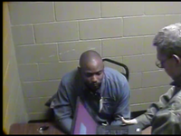 Sgt. James Young (right) brought in a laptop to show Michael Cunningham the surveillance video of what happened outside the convenience store. Young and fellow officer Haber. now the Balch Springs chief, said the video did not show an assault. A federal judge disagrees. (Balch Springs Police Department)