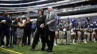 Dallas Cowboys owner Jerry Jones and his wife, Gene Jones, are introduced during a Cowboys Kickoff Luncheon at Cowboys Stadium in Arlington.  (2013 File Photo/Staff)