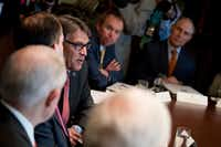Energy Secretary Rick Perry, center left, said this budget process isn't his first rodeo given his 14 years of experience as governor of Texas. (Andrew Harnik/The Associated Press)