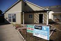 A sign advertising an open house for a foreclosed home on Munger Avenue in Dallas.(Sonya N. Hebert/Staff Photographer)