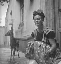 """Frida with Granizo,"" by Nickolas Muray, Courtesy of Throckmorton Fine Art. 1939. Part of ""Mirror, Mirror: Photographs of Frida Kahlo"" at the Museum of Spanish Colonial Art in Santa Fe.(Nickolas Muray)"