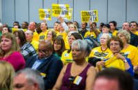 Cotton Belt supporters hold up signs as the board of the Dallas Area Rapid Transit voted to finance both the Cotton Belt and D2 subway plans for a rail corridor on Tuesday, October 25, 2016 at DART headquarters in Dallas.(Ashley Landis/Staff Photographer)