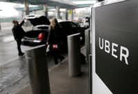 In this March 15, 2017, file photo, a sign marks a pick-up point for the Uber car service at LaGuardia Airport in New York. <br>(Seth Wenig/AP)