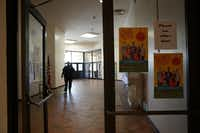 A security guard walks the halls at Manns Education Center in Dallas on June 21, 2017. The school board will vote this week on whether to close the school.(Lawrence Jenkins/Special Contributor)