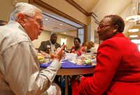 Roy Vandiver talks with Juanita Pounds at the Together We Dine event.(Jae S. Lee/Staff Photographer)