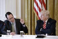 "President Donald Trump praised AT&T boss Randall Stephenson for doing ""really a top job."" Did the President know that AT&T was paying his personal lawyer $600,000 for ""insights""?(Getty Images)"