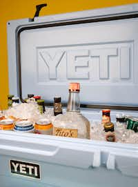 An ice blue Yeti cooler filled with Texas-made beer and vodka.(Rose Baca/Staff Photographer)