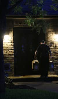 Amazon.com's Carlos Cepeda delivers groceries on Clayco Drive in the Lake Highlands area of Dallas early morning on June 21.(Irwin Thompson/The Dallas Morning News)