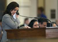 Texas Rep. Ana Hernandez Luna wipes away tears as she addresses the House chambers on May 10, 2011, in Austin.(Deborah Cannon/AP)