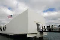 This Monday, Dec. 7, 2009 file photo shows the USS Arizona Memorial during the 68th anniversary ceremony of the attack on Pearl Harbor at Pearl Harbor Naval Base in Honolulu.(Marco Garcia/AP)