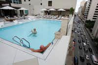 Hotel guests Sam High (left) and Jason Cook, both of Little Rock, Ark., enjoyed the new pool on the seventh floor of the Adolphus hotel last fall.<div><br></div>(Ben Torres/Special Contributor)