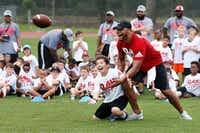Dallas Cowboys quarterback Dak Prescott defends Sammy Mercer, 12 of Shreveport during a drill at the Dak Prescott Football ProCamp at Haughton High School in his hometown in Haughton on Thursday, June 22, 2017.(Vernon Bryant/Staff Photographer)