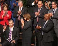 The Dallas City Council — including, at far right, T.C. Broadnax — gave Mayor Mike Rawlings a standing ovation after his remarks at the new council's inauguration last week.(Louis DeLuca/Staff Photographer)