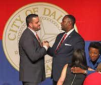 Dallas city councilmen Adam McGough (left) and Casey Thomas at the council's inauguration last week.(Louis DeLuca/Staff Photographer)