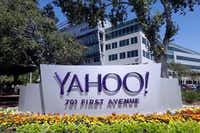 In this July 2016 file photo, flowers bloom in front of a Yahoo sign at the company's headquarters in Sunnyvale, Calif.(Marcio Jose Sanchez/AP)