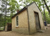 A replica of Henry David Thoreau's one-room cabin at Walden Pond in Concord, Mass.(The Associated Press/2003 File Photo)
