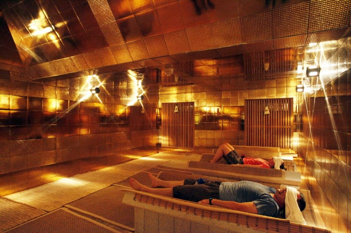 Nathan Kelley and Jeanne Kelley relax inside the golden pyramid dry sauna  at Spa Castle hotel and resort, on Wednesday, Feb. 19, 2014 in Carrollton.