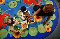 Antonio Tejedor (left), Caydance Jones (center) and instructor Yashekia Mitchell construct a pen for their zoo animals at CP Preparatory School in Mesquite. Mesquite ISD is dipping deeper into early intervention by partnering with day cares to provide free pre-K for qualifying 3-year-olds. (Tom Fox/Staff Photographer)