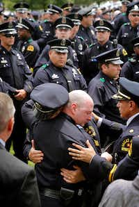 Dallas police officer comfort one another following the police Honor Guard Ceremony for officer Michael Krol outside of Prestonwood Baptist Church in Plano, Texas, Friday, July 15, 2016. Krol was gunned down in an ambush attack in downtown Dallas a week ago. Four Dallas police officers and one DART officer were killed and several survived. (Tom Fox/The Dallas Morning News, pool photo)(Tom Fox/Staff Photographer)