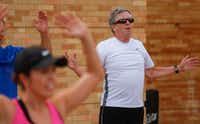 Dan Short, 72, gets in a round of jumping jacks at a Camp Gladiator boot camp workout.<div><br></div>(Ron Baselice/Staff Photographer)