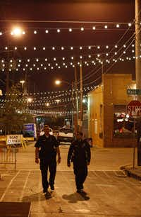 Off-duty police patrolled Deep Ellum last fall as part of private patrols paid for by businesses.(Nathan Hunsinger/Staff Photographer)